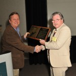 Dick Neece presents award to Chuck Orman